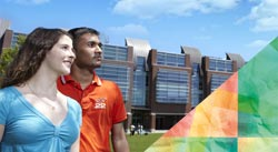 A male and female studnet looking at the UOIT buildings